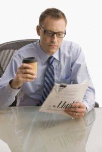 businessman reads